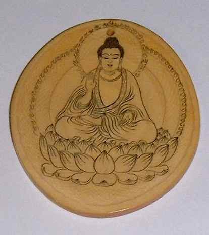 Ancient Ivory carving of Lord Buddha